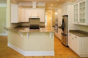 Kitchen with angled peninsula, white kitchen cabinets with
