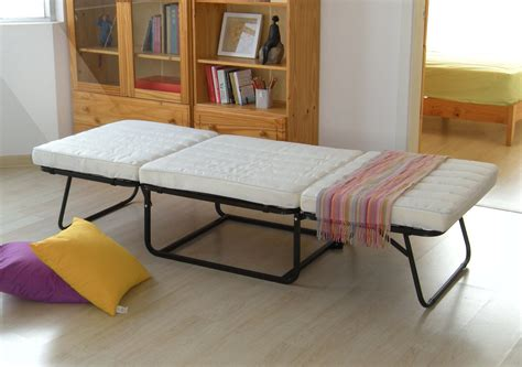 Small Kitchen Apartment Ideas - convertible ottoman folding bed with white mattress and black metal base ideas