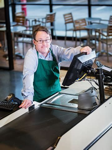 Man With Down Syndrome Working At Supermarket Checkout ...