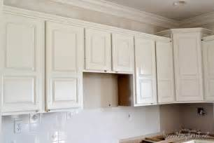painting kitchen cabinets white by beneath my heart