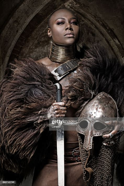 Beautiful Black Warrior Princess Holding A Sword In Studio ...
