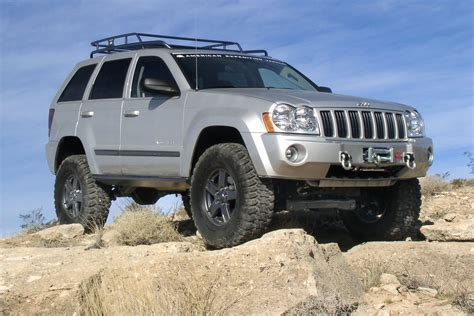 raised jeep grand cherokee red jeep commander lifted image 138