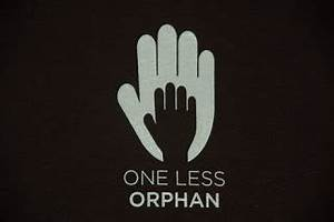 Love makes a family: One Less Orphan T-Shirts