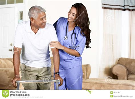 health care worker and elderly man stock photo image