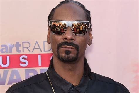 """American rapper, singer, songwriter, actor, record producer, media personality, and businessman. Snoop Dogg says he was """"brainwashed"""" into thinking he couldn't vote - REVOLT"""