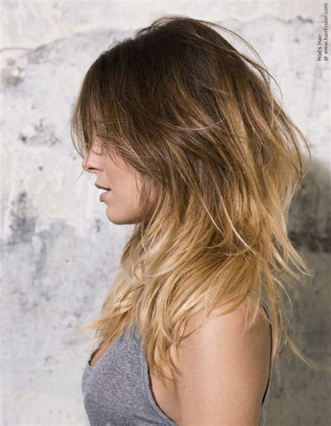 casual long hairstyle  layers light blonde tips
