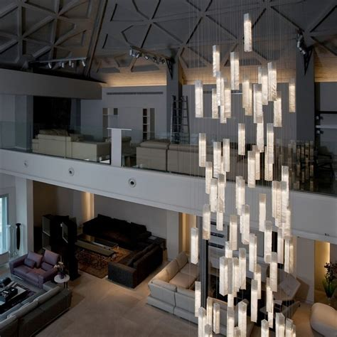 modern chandeliers for high ceilings elegance en masse a flurry of pendants is the center