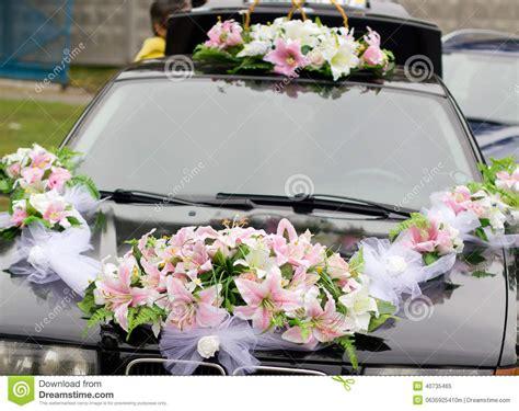 black wedding car decorated  white roses stock photo