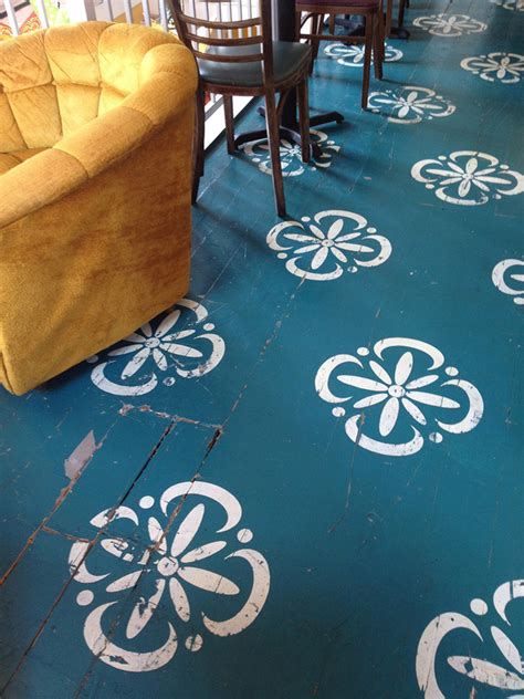 top  stencil  painted rug ideas  wood floors