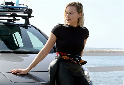 surf  inspire actress margot robbie pulls  wetsuit