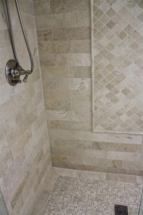 neutral tile shower  diamond pattern hgtv