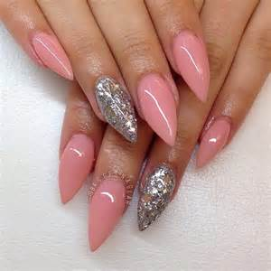 Red and pink almond acrylic nails are romantic feminine