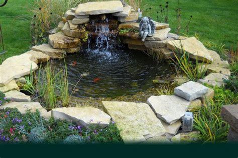 Small Backyard Koi Pond Design With Stone Border And