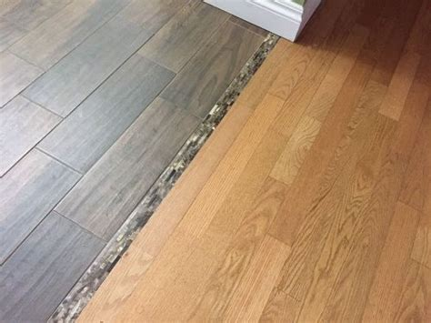 The top layer is vinyl, the middle is a high density core board and usually there is an attached back in my opinion, i prefer the engineered vinyl plank flooring as it looks and feels more real. Transitioning hardwood floor to tile floor-is there a better way? | Hometalk