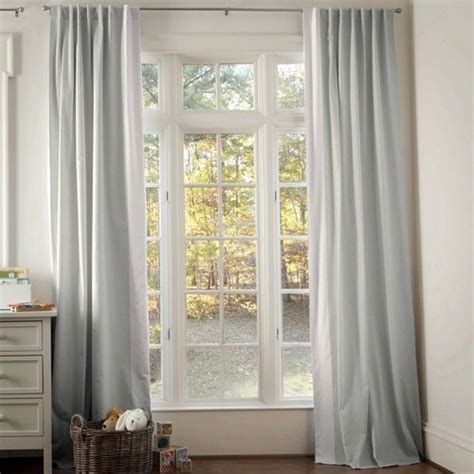 light pink linen tab drapes with vertical trim