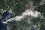 Sakura-jima volcano emitted a dense plume of ash over the ...