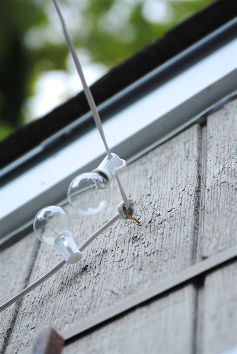 wall cord how to hang outdoor string lights the deck diaries part