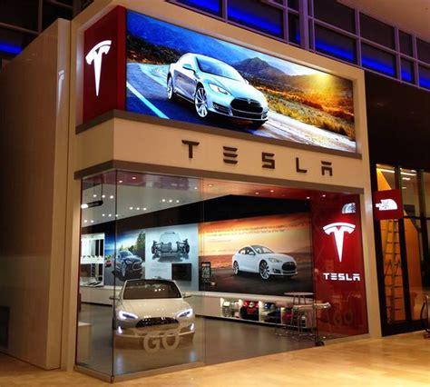 tesla motors opens  canadian store  toronto