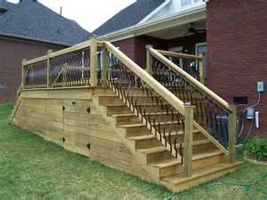 deckorators spindles wood deck with horizontal skirting