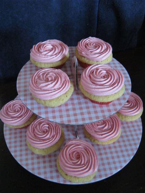 vanilla cup cakes  pink buttercream icing swirl