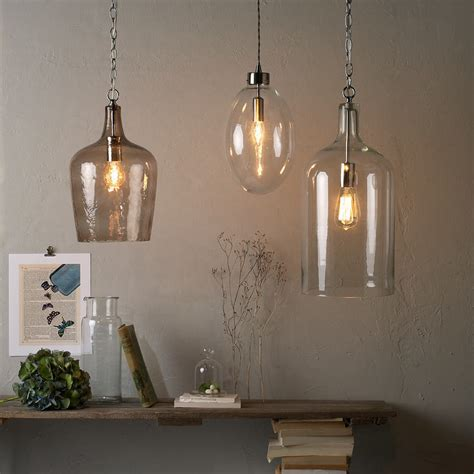 glass bottle pendant lights moody monday