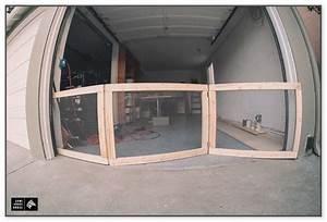 Garage door dog gate goldenacresdogscom for Dog door for garage door