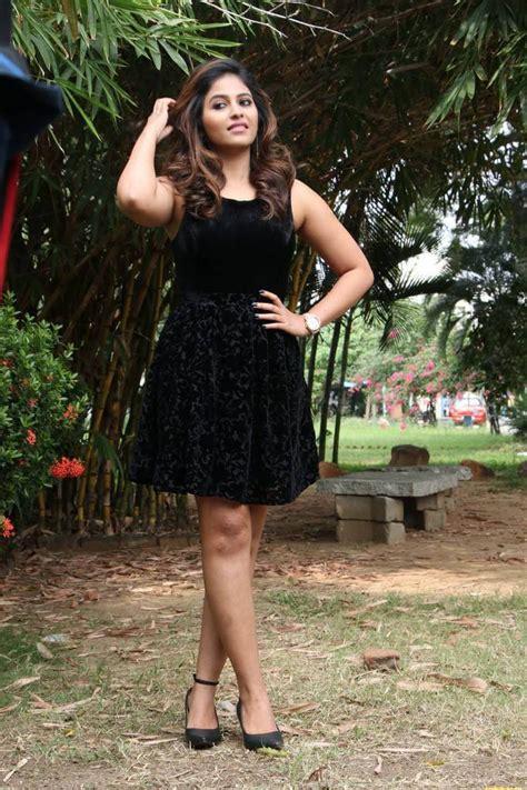 anjali cross legs  mini black skirt  balloon