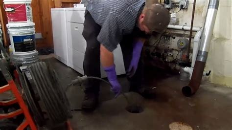sewer snake  unplug  clogged drain pipe