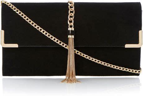 dune edgie chain tassel clutch bag  gold black suede lyst