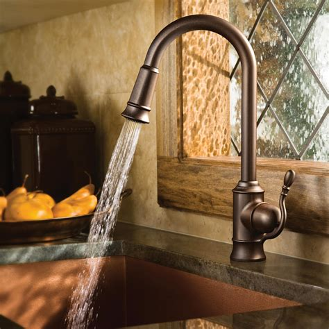 rubbed bronze kitchen sink faucet moen 7615orb woodmere one handle high arc pulldown kitchen 8982