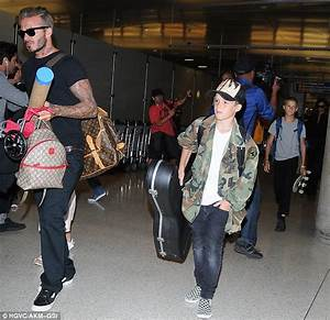 Harper Beckham holds hands with doting dad David at LAX ...