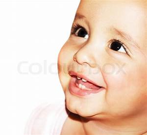 Closeup Portrait Of Beautiful Happy Baby Face Over White