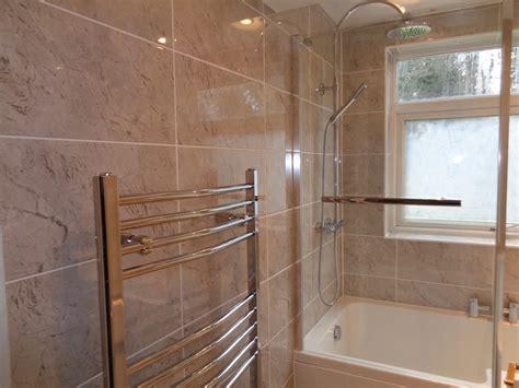 shower bath bathroom suite fitted  tiled walls  floor