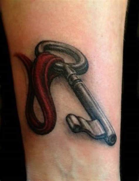attractive key wrist tattoos