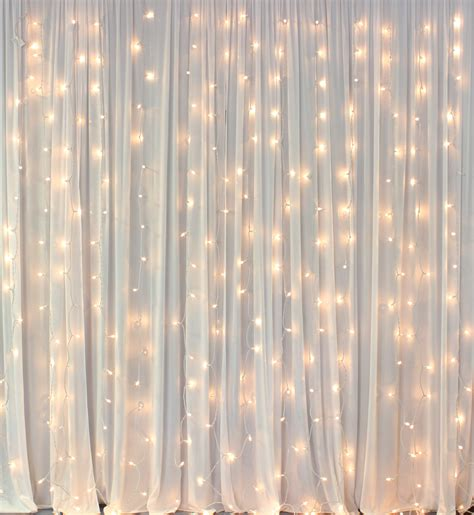 white backdrop with lights backdrop draping