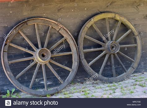 Old Wooden Wheels For Horse Cart. Open-air Museum Where