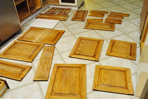 spraying kitchen cabinet doors prepping cabinets for paint sanding deglossing wood 5663