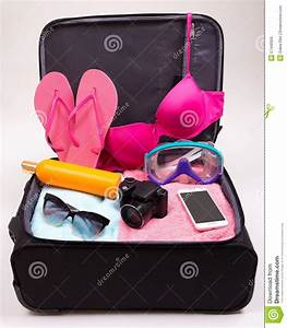 Preparation For Trip Concept - Open Suitcase Full Of ...