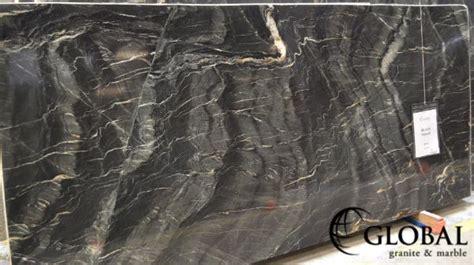 black vogue granite a black background with wispy veins