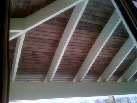 painted rafters  stained beadboard white beams