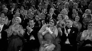 1930s Wide Shot Elegantly Dressed Audience Sitting In ...