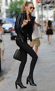 Picture Of leggings boots a long top and a leather jacket