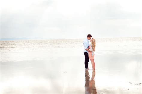 Romantic Peach And Blue Engagement Shoot By The Beach