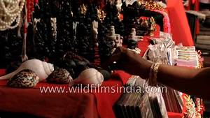 People buy religious souvenirs outside Pashupatinath ...