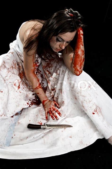 yelling woman  knife  blood  black background