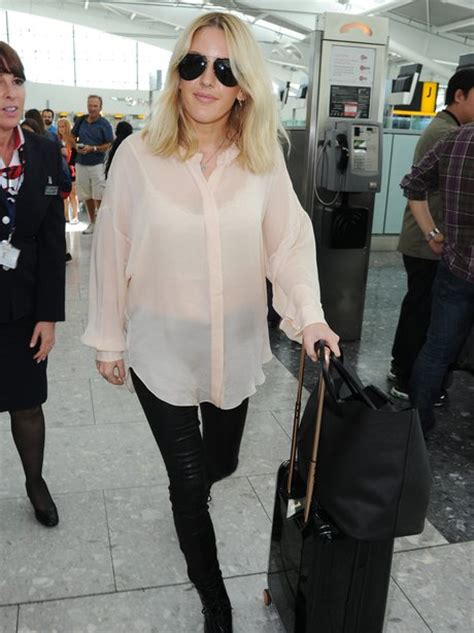 Ellie Goulding looking TRES chic in her sheer shirt as she ...