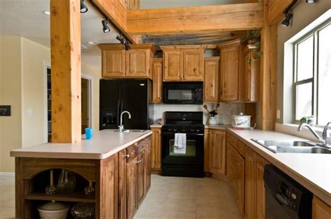 photo  rustic cherry kitchen cabinets