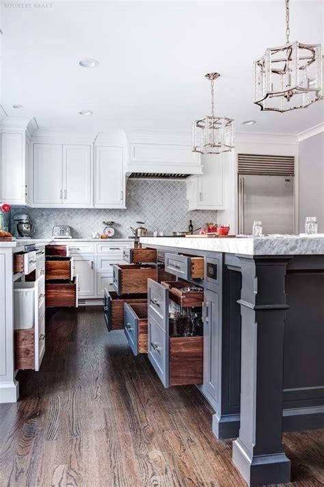 wrought iron kitchen island  white cabinets  towaco