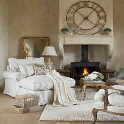 Cozy living room with white grey striped sofa bed for Cozy living room with fireplace