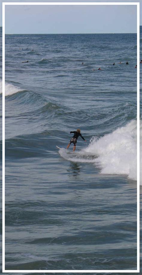 surfing  juno beach pier